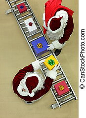 santa clauses at conveyor belt