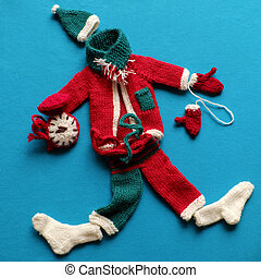 Santa clothes, gloves, hat, scarf, socks on blue background for Christmas