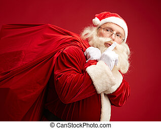 Santa coming - Portrait of Santa Claus with huge red sack...