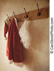 Santa costume hanging on coat hook