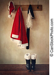 Santa costume with boots on rack