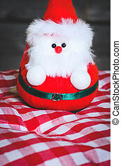 Santa doll with wooden background.