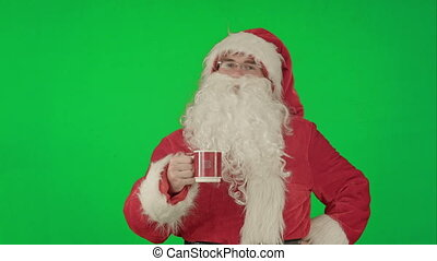 Santa drinks from a red cup on a Green Screen Chrome Key -...