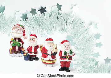 Santa Figures with Tinsel Background