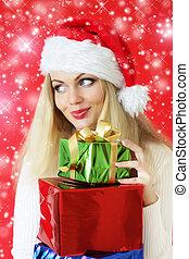 Santa girl holding gifts