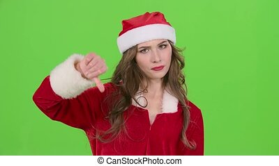 Santa girl in suit shows thumbs down. Green screen. Close up