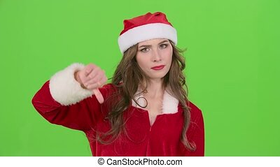Santa girl in suit shows thumbs down. Green screen. Close up. Slow motion