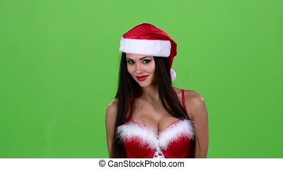 Santa girl in suit shows thumbs down. Green screen