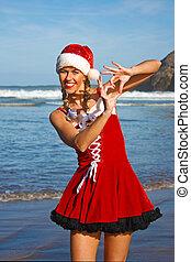 Santa girl on the beach