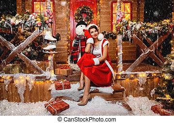 santa girl with snowman
