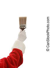Santa Hand & Paintbrush - Santa Clause hand holding a three...