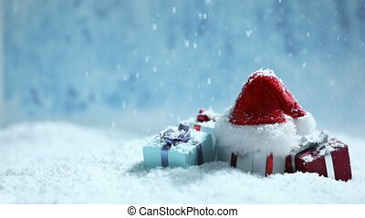 Santa hat and gifts in snow - Santa hat and decorated gifts...