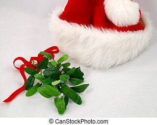 Santa Hat & Mistletoe - A red santa claus hat with a sprig...