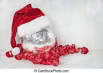 Santa hat on silver ornament