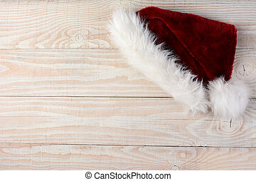 Santa Hat on Wood Surface