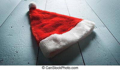 Santa hat on wooden background,