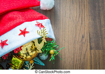 Santa Hat with Christmas decorations on wooden background