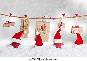 Santa hats and stars in snow