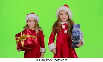 Santa helper are holding boxes with gifts and showing a thumbs up. Green screen