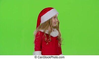 Santa helper in a red suit are standing in the room and...