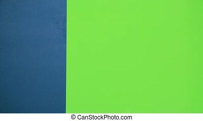 Santa helper peeking out from behind the blue board. Green screen