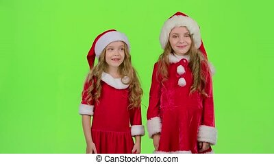 Santa helper say quietly to their elves. Green screen - Baby...