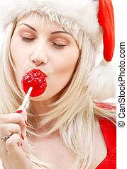 santa helper with lollipop - pretty blond in santa helper...