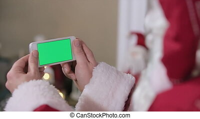 Santa Hold Phone in Hands Chroma Key. Phone with Green Screen in Landscape Mode. Easy for tracking and keying. Pro Res HQ codec