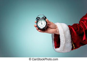 Santa holding an old alarm clock