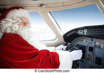 Santa Holding Control Wheel In Cockpit Of Private Jet -...