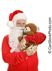 Santa in his pajamas giving a hug to his well worn and much loved teddy bear. Isolated on white.