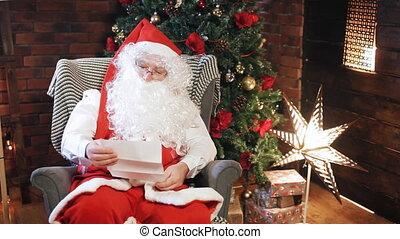 Santa is reading a letter from a child