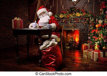 Santa is working - Santa Claus is preparing for Christmas,...