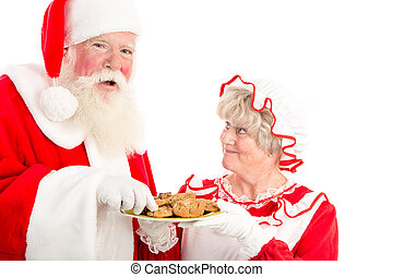 SAnta laughs and takes cookie - A laughing Santa takes a...