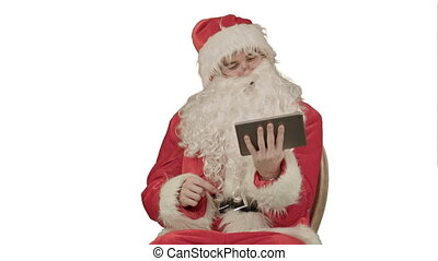 Santa listening music and touching tablet on white background