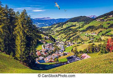 Santa Maddalena (Santa Magdalena) village with magical Dolomites mountains in background, Val di Funes valley, Trentino Alto Adige region, South Tyrol, Italy, Europe. Santa Maddalena Village, Italy.