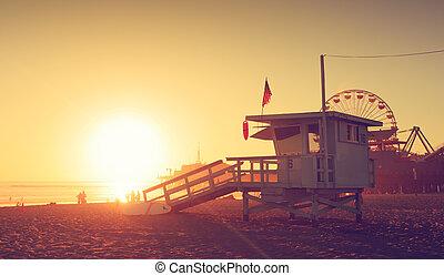 Santa Monica beach lifeguard tower in California USA at sunset