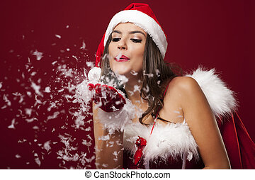 santa, mulher, com, natal, saco, soprando, snowflakes