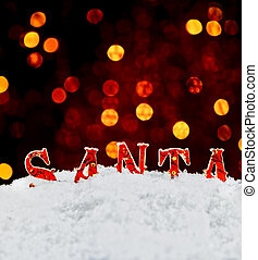 Santa name in the snow with bokeh background