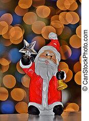 Santa ornament with bokeh lights.