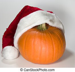 Santa Pumpkin putting on his hat
