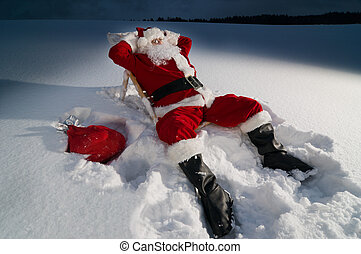 Santa relaxing on a sunbed - Santa claus relaxing on a ...