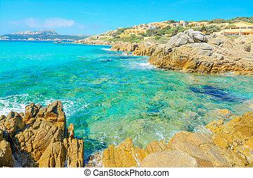 yellow rocks by Santa Reparata beach in Sardinia