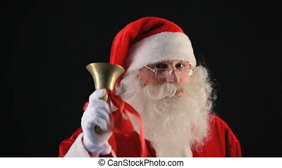 Santa ringing bell - Santa Claus ringing a golden bell with...