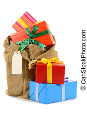 Santa sack full with pile of Christmas gifts isolated on white background