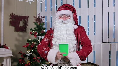 Santa Shows Finger On Tablet with Green Screen in Vertical Mode. Easy for tracking and keying. ProRes HQ codec
