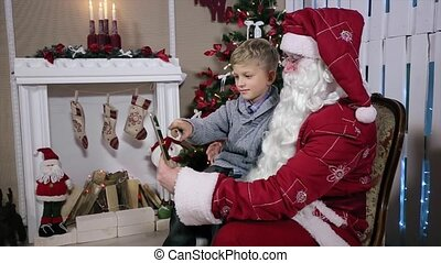 Santa Shows How to Choose a Gift on Tablets