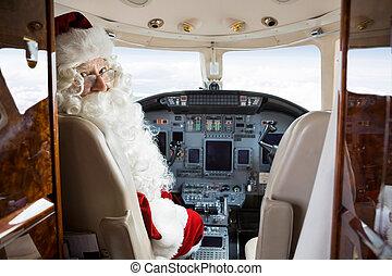 Santa Sitting In Cockpit Of Private Jet