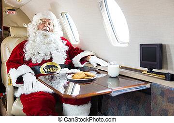 Santa Sleeping In Private Jet