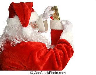 Santa Stuffs Stocking - Santa Claus stuffing a Christmas...